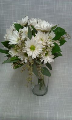 Simple white daisies give this bouquet a fresh picked feel perfect for any outdoor wedding ceremony.