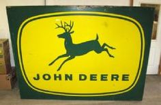 John Deere sign [four legs]  |  the number of legs on the deer have changed as the trademark has evolved through the years  |  vintage signs