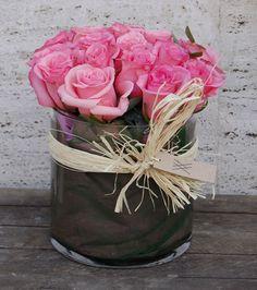 Un bonito centro de rosas