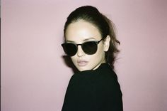 It's the holiday season and we're feeling cozy. Our lookbook, Studio Confidential, sees George in classic frames, spending some downtime inside a suite decked with pink walls and plush couches. Come on in. #sunniesstudios #georginawilson