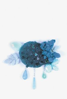 Julia Baudler, <em>#1</em> brooch, 2014. 925 silver, resin, acrylic, silicone, glass, emerald, aquamarine, turquoise. Photo Sarah Beekmann