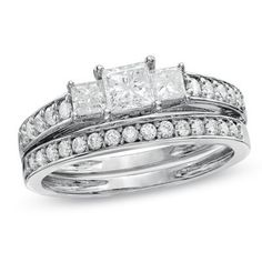 Very inexpensive, this three stone diamond wedding ring set is hand carved and set with glittering diamonds that would enchant her at the very first site. A perfect wedding set, this unique and affordable diamond wedding set is the perfect bridal ring that you are looking for.
