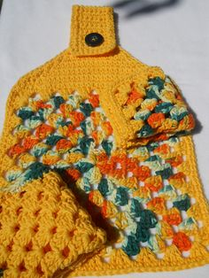 $14 Cotton Kitchen Towel and Dishcloths.  Really beautiful combination of yellow, orange and teal.  Handmade