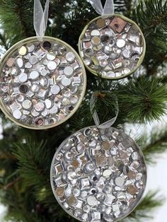 Looking for a great budget Christmas idea but don't have a lot of money? You'll love these recycled DIY ornaments made from jar lids! So easy even kids can make them! Awesome cheap craft with dollar store rhinestones that looks great.