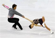 Shen Xue (R) and Zhao Hongbo of China perform during the pairs short programme figure skating event at the Vancouver 2010 Winter Olympics Fe...