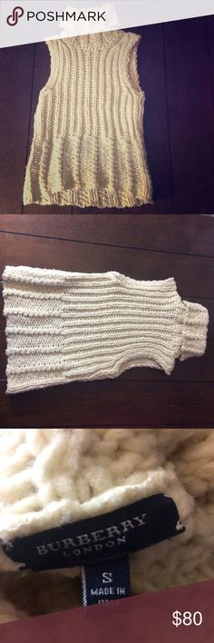Burberry knitted sleeveless sweater Woman's size small Burberry sleeveless turtleneck sweater. Cream/off white. 75% wool 25% nylon. Some fuzziness happening (typical with wool) bust measures 15 inches flat across. Length is 21 inches. Is a little stretchy. Burberry Sweaters Cowl & Turtlenecks