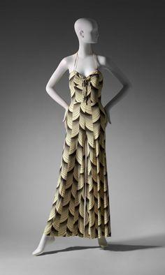 Brown and cream geometric printed halter-neck pants dress. Flared legs. Backzipper.  Early 1970s. Boston MFA.