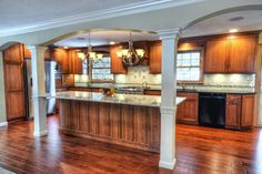This family wanted an open kitchen feel. We combined their formal dining room with small galley kitchen, to create this spacious family centered space, usable for any serious cook! The space is proportionate and flows beautifully with the rest of this 1980-s bi-level. Designed by Capozzi Design Group http://www.capozzidesigngroup.com