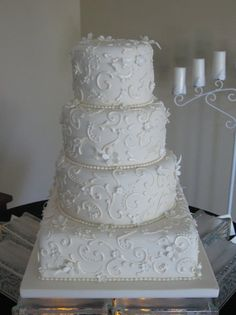 Ivory fondant with pearlized scroll work and flowers.