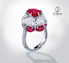 Forms Jewellery, Hong Kong. A ring featuring a 3.85ct ruby from Mogok set with with 6 triangle shaped diamonds each weighing over 1ct and 6 Burmese ruby cabochons over 1ct each