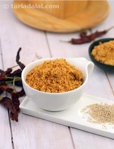 Peep into any south indian larder, and you are likely to find a good stock of 'podis' or dry spice-dal blends that can be served as side dishes or even mixed with rice and served, for a simple main course meal. Here is a healthy powder made with sesame seeds that can be mixed with rice and til oil and served with papads, for a quick and tasty treat.