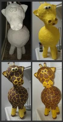 Homemade Giraffe Pinata: DIY pinata for a safari themed birthday party using two balloons - one for the head and one for the body.