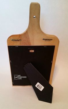 use a picture frame easel to make chalkboard cookbook kitchen stand out of a cutting board MyRepurposedLife.com