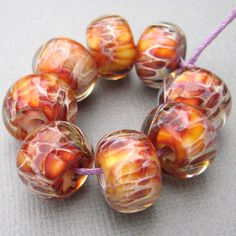 Boro Beads - Lampwork Glass - Amber, Orange, Pink and Red. $26.00, via Etsy.