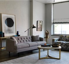 mix in traditional tufting on modern upholstery frames, like this chester sofa, with modern art to create the modern minimalist lifestyle.