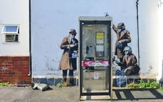 Banksy's latest work? Mural near GCHQ depicts secret agents listening in on a phone box - Telegraph