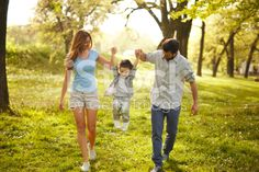 Happy family heaving fun in the park royalty-free stock photo