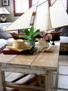 Coastal decor with boat, shells....I love this table!