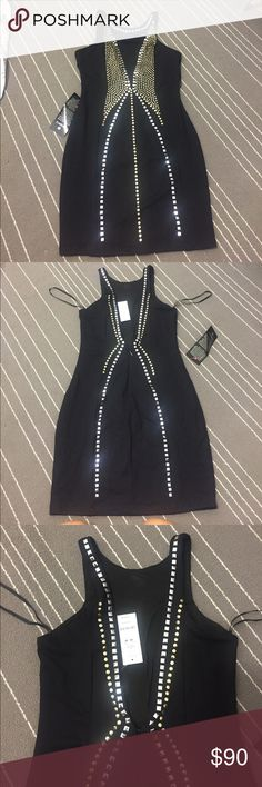 💋 BEBE studded dress Super sexy and form fitting Dress. With Gold and silver stuffs. Has been kept packaged so it's intact. It's very form fitting and had a v neck open back that doesn't go to low. Brand new! bebe Dresses Mini