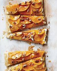 Butternut Squash Glazed Tart Recipe from Food & Wine | This elegant puff pastry is quick to make. You'll be surprised at how delicious butternut squash is for dessert. Look for a squash with a long neck. | Thanksgiving, Christmas, Holiday Dessert, Butternut Squash, Puff Pastry, Cream Cheese, Cinnamon, Apricot Preserves, Toasted Pecans