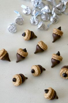 Acorn Treats: Create Thanksgiving Dessert with fun Acorn lookalikes using Hersheys Kisses and Nutter Butters - learn how to quickly put together acorn cookies to gift or display for holiday treats, no recipe required