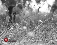Engagement shot in the grass