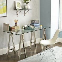 Upgrade your work space. With a clean, chrome-finished metal base, our classic trestle style Cross Base Desk features a wide glass top so you can spread out your work—or pull up extra chairs for an impromptu dinner party.