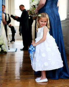 A voluminous Annie Girl dress had this young attendant looking absolutely precious