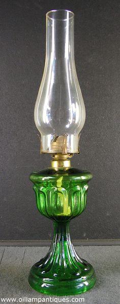 Antique emerald green glass Long Loop oil lamp