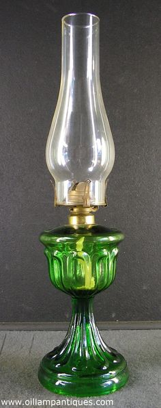 Antique emerald green glass Long Loop oil lamp