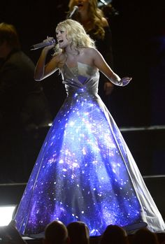 What a dress! Carrie Underwood truly shines while performing at the 55th Annual Grammy Awards.