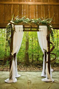 diy wedding arbor decor | Different flower arrangement maybe...
