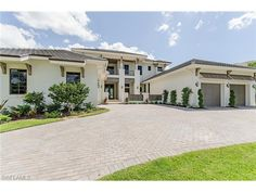 272 Mooring Line Dr, Naples, FL 34102   Waterfront new construction West Indies style home on Hurricane Harbor complete with boat dock in the Moorings.