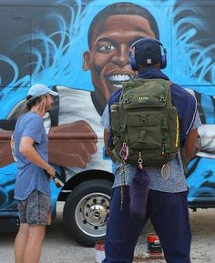 Cam Newton standing in front of his food truck, Smokn' Aces. Courtesy of Mark Paul Deren \http://www.panthers.com/news/article-2/Panthers-try-Cam-Newtons-food-truck/59ab482c-c12e-44a2-9896-adec5952e4d4+ Panthers try Cam Newton's food truck.