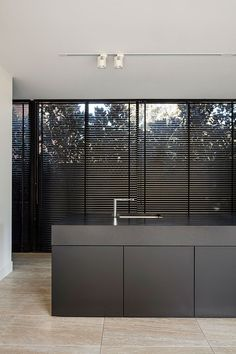Black kitchen with extra thick work top.