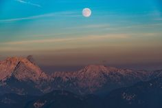 Moon is rising just as the sun is setting by Aleš Krivec on 500px