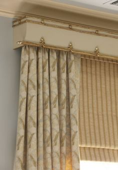 Very attractive cornice. the trim appears to be gold colored metal. Subtle & elegant. Rinfret, Ltd.