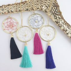 "My absolutely favorite creation (although my fingers don't agree).  Handwoven Dreamcatchers with center matte gold heart. Dreamcatcher has a center diameter of 2""   Chain (16k plated gold) is dainty yet strong and measures 24"" long with lobster clasp closure  Tassels are made of 100% Silk ..."