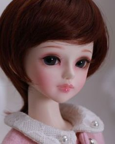 "As a rule the big-eyed dolls don't appeal to me. I do rather like this little girl, though.  Doll Love, Sweet (43 cm) ""May"""