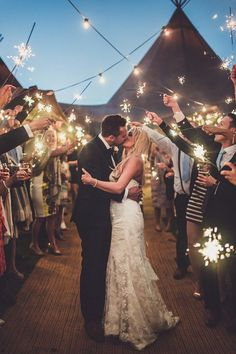 Stunning end of the wedding night shot with sparklers lining the path!