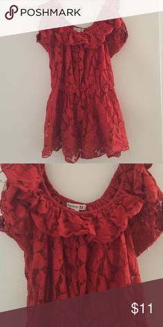 Red Lace peplum style top Flirty red lace top with an elastic too and waist so it stretches to fit and can be worn off the shoulder.  Also has a top ruffle detail. Forever 21 Tops