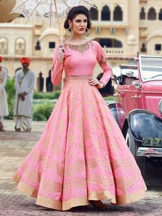 This Pink Silk Anarkali that looks like a two piece outfit is perfect as an indian reception bridal gown; The soft pink color is amazing