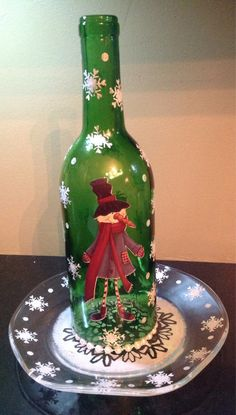 Cute Snowman on a recycled wine bottle made into a candle holder.