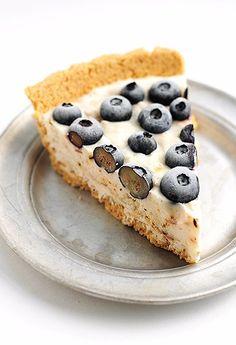 A super easy Frozen Coconut Blueberry Yogurt Pie Recipe.