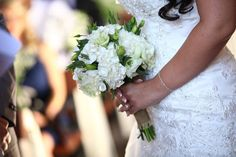 Simple and elegant wedding bouquet with beautiful hydrangeas and hessian