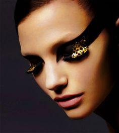 Gold embellished lashes.