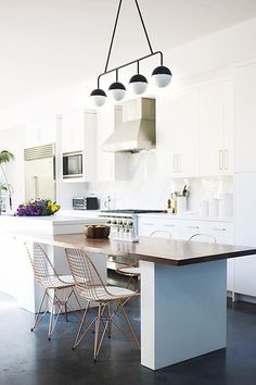 would be cool to have a lower table drop down like this if there was the space.  Black floors and white cabinets are quite the nice combo. Black & White - 15 Times Dark Floors MADE The Space - Photos
