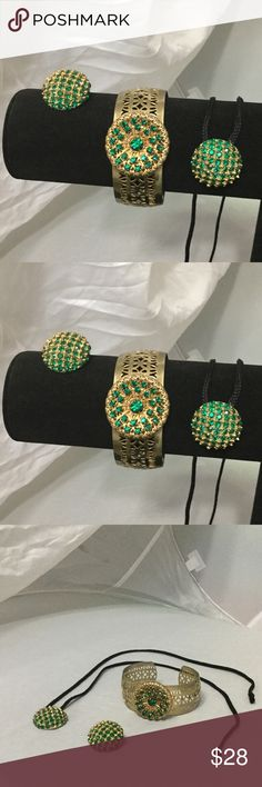 """🍀 Vintage Gold & Emerald Rhinestone Cuff Set 🍀 Very beautiful and well made, no stones missing.  When I obtained this set, it was only 1 Clip on earring, so I removed the clip on and converted it to a gorgeous pendant.  Recently I discovered the cuff bracelet and other earring as they were not bundled together!  Thus I am selling this at a very reduced price.  Cuff measures 2.5"""" Diameter x 1"""" Wide, Circle on top is 1.25"""" Diameter; Earring and Pendant are 1"""" in Diameter.  Thank you for…"""