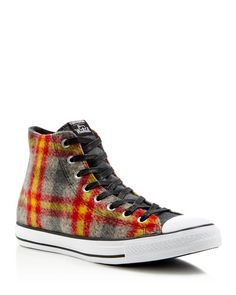 Traditional Woolrich plaid warms up Converse's classic high-top sneaker to provide as much warmth as it does classic style. | Wool/rubber | Imported | Lace up closure | Wool upper | Rubber sole and