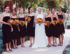 Black bridesmaid dresses, each maid has a dress unique to her